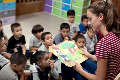 Projects Abroad Care volunteer reads a story to children at her project in Costa Rica