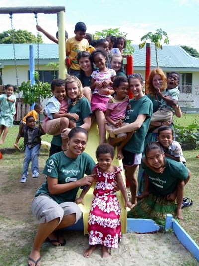 A group of Care volunteers with children at their placement