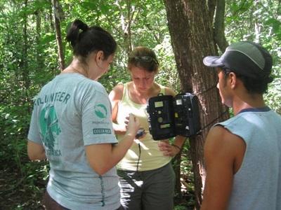 Volunteers learn how to set up sensor cameras