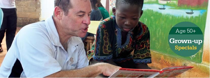 A volunteer reads to a child on a Grown-up Special placement